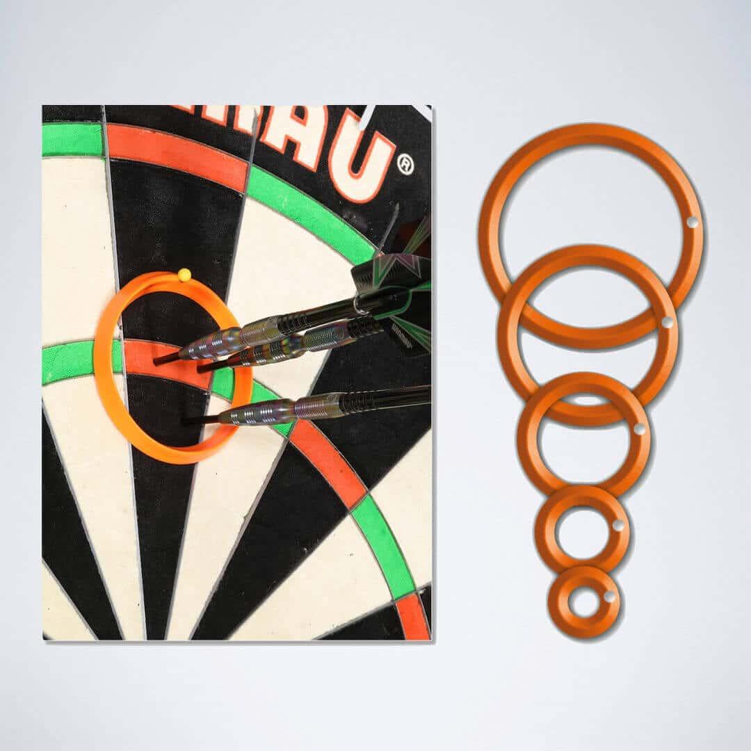 5 verschiedene orangene Darts Practice Rings und 1 Dart Ring an der Dartscheibe